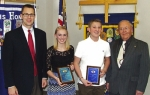 Katie Olinger (second from left) and Paul Helmich (third from left) have been recognized as Outstanding Eighth-Graders from Crestview Middle School by the Huntington Metro Kiwanis Club. With them are Crestview Principal Chuck Werth (left) and Huntington Metro Kiwanis member Jim Dinius (right).