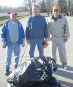 Roanoke Kiwanis Club members (from left) Mike Gibson, Alan Amick and President Butch Wygant pose with some of the trash they picked up along US-24 in Roanoke.
