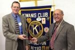 John Mason (left), incoming president of the Huntington Metro Kiwanis Club, receives the gavel from outgoing president Carl Zinsmeister.