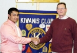 Huntington North senior Aum Patel (left) accepts the John Michael Memorial Scholarship from John Mason, Huntington Metro Kiwanis scholarship chairman, in the amount of $1,000. Patel plans to major in premedical biology at Indiana University next fall.