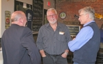 Ron Kline (middle) cracks a smile at a Republican Party gathering at The Berg Ale Haus, in Huntington, in the aftermath of the race for the three GOP nominations to the at-large seats on the Huntington County Council. Kline, along with incumbent Shane Bickel and Terry Miller, came away with the nominations.