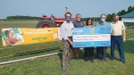 Eric Halvorson, manager of corporate affairs, Kroger Central Division (left) presents a check for $100,000 to Community Harvest Food Bank on Aug. 26. Celebrating the donation are (from left) Halvorson; Chad Cumberland, Shared Harvest Farm; Carmen Cumberland, president of Community Harvest Food Bank and owner of Shared Harvest Farm; John Wolf, CEO of Community Harvest Food Bank; and Burt Brunner, treasurer, Community Harvest Board of Directors.