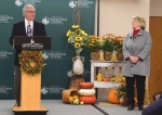 As Huntington University President Dr. Sherilyn Emberton (right) stands by, Bob Krouse speaks from the podium about his father-in-law and the new HU animal barn's namesake, Don Strauss. The Don Strauss Animal Science Education Center will house key livestock of HU's agricultural degree program.