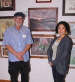 "Goven Martinez (left), of Huntington, stands with Sayaka Ganz, a renowned sculptor who judged the LaFontaine Arts Council's Regional Art Show and awarded him ""Best of Show"" honors for his oil painting titled ""Morning Mystery,"" which is pictured above them. The Regional Art Show will be on display in Huntington University's Robert E. Wilson Gallery, located in the Merillat Centre for the Arts, through Aug. 28."