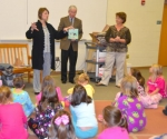 Aimee Lunsford (left), principal of Flint Springs Elementary School, introduces her second grade students to Marshall Sanders (center) and Jeri Davis, board members for the Huntington County Literacy Coalition.