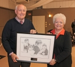 Allan Sather (left) receives the 2018 Pathfinder Services Herbert D. LaMont Award from LaMont's daughter, Diane Adams, on behalf of his brother, Britt Sather, owner of the Huntington McDonald's restaurant.  The award was presented during the Pathfinder Services annual recognition dinner held Thursday, Nov. 8.