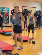 Participants work out at a recent Body Pump class held at the Parkview Huntington Family YMCA. Pictured are (from left) Sydney Evans, Ryan Payne, Sara Payne and Cori Mills.