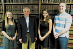 Recipients of scholarships from the law firm of Bowers, Brewer, Garrett & Wiley, LLP pose with attorney Robert S. Garrett. They are (from left) Kaitlyn Oswalt, Garrett, Merrideth Goetz and Nathan Lundy.