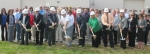 Students, educators, investors and others gather behind the shovels for a ceremonial groundbreaking of the new Huntington Learning Center expansion project on Wednesday, Oct. 7. The project will cost $1.45 million and add more than 7,500 square feet to the current vocational center. Manning the shovels are (from left to right) Matt Schenkel, of Shawnee Construction & Engineering; Randy Harris, of Huntington County Community School Corporation; Kari Vilamaa, of Barton-Coe-Vilamaa Architects and Engineers; Huntington Mayor Brooks Fetters; Steve Kimmel, of Huntington County Chamber of Commerce; Jerrilee Mosier, of Ivy Tech Northeast; Huntington County Commissioner Tom Wall; and Karen Green, of North East Indiana Works/WorkOne.