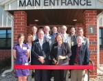 Members of the Huntington County Community Learning Center Development Team prepare to cut the ribbon to officially open the facility on Thursday, Sept. 15. Pictured are (front row, from left) Jenna Strick, Randy Harris, Tiffanney Drummond and Dana Wannemacher; (second row, from left) Lisa Smith, Steve Kimmel, Rick Farrant and Randy Prange; (third row, from left) Ed Vessels, John Niederman and Adam Drummond; and (fourth row, from left) Jon Bennett, Tracey Shafer and Steve Schenkel.