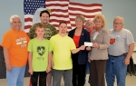 Members of the Ladies' Auxiliary to American Legion Post 85 raised $1,400 through a lasagna dinner and bake sale, presenting the gift to Huntington County Special Olympics on Tuesday, May 17. Celebrating the donation are (front, from left) Nancy Hartley, Huntington County Special Olympics coordinator; Special Olympics athletes Christian Smith and Matthew Hartley; Auxiliary President Jean Watson; Ardella Moriarity, who chaired the dinner; and Keith Hartley, Huntington County Special Olympics coordinator; and (back, from left) Nicholas McKoon, Special Olympics athlete, and Wally Elston, who prepared the lasagna for the dinner.