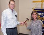John Mason (left), outgoing president of the Huntington Metro Kiwanis Club, hands the gavel to the club's incoming president, Lisa Leist.
