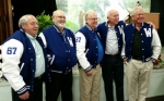 Don Wood (left) arranged a surprise presentation of letter jackets to fellow members of the Class of 1967 (from left) Lew Morrison, Denny Stroud, Reed Shafer and George Kriegbaum. The five men attended Warren High School through their junior years, but missed out on receiving letter jackets when Huntington County schools were consolidated the following year.