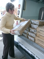 Huntington County Assessor Terri Boone loads th last tray of property assessment for the post office to mail out at the turn of the year.
