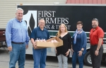 """First Farmers Bank & Trust recently donated more than 500 pounds of unseasoned ground pork to two Huntington County agencies as part of its """"Pigs to People to Pork"""" Initiative. The Love INC food pantry was one of the agencies receiving the pork. Shown are (from left) Doug Wilcox and Mark Wolf, of First Farmers; Kelley Miller, assistant director of Love INC.; Erin Didion, director of Love INC; and Mike Belcher, of First Farmers."""