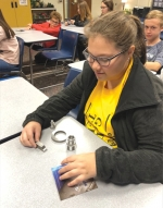 Huntington North High School student Audrey Ranc participates in a National Manufacturing Day activity on Friday, Oct. 4. Industry representatives visited classrooms to talk about potential careers in manufacturing.
