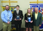 The Huntington Metro Kiwanis honored eighth grade students Blaise Rupley (second from left) and Lindsay Godfroy (third from left) from Huntington Catholic School with its outstanding youth awards at a recent club meeting. Pictured with them are HCS Principal Derek Boone (left) and Jim Dinius (right), past Kiwanis Lt. Governor.