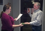 Markle Town Councilman Rick Bower (right) is sworn into his next four-year term in office by town Clerk-Treasurer Shelley Monticue during the town council's meeting Wednesday, Feb. 18.