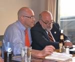 Huntington Mayor Brooks Fetters (right) and his brother, Todd Fetters, keep track of vote totals during a Republican gathering at The Berg Ale Haus after polls closed on Tuesday, May 5. Fetters won the Republican nomination and will run in November for a second term in office.