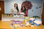 Emily Adkins (left), of Paul Davis Restoration and Remodeling, presents a check, toys and office supplies to Jessica Broyles, executive director of McKenzie's Hope, onWednesday, Nov. 30. The donations represent contributions from Paul Davis' clients. The company chose McKenzie's Hope as its charity of the month for October.