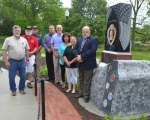 The first group of personalized bricks honoring local Purple Heart recipients is now in place at the base of the Purple Heart monument at Memorial Park. Showing off the bricks are (from left) Tim Eckert, Huntington County veterans service officer; Larry Jenks, commander of Veterans of Foreign Wars Post 6671 in Markle; Tom Clounie of Clounie Landscaping, who laid the bricks; Anthony Goodnight, director of public works and engineering services for the City of Huntington; Steve Kimmel, Juanita Hedrick and Gloria Holzinger, members of the Purple Heart monument committee; and Huntington Mayor Brooks Fetters.