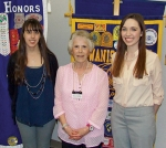 Savannah Moyer (left) and Hannah Nissley (right) are pictured with Huntington Metro Kiwanis Scholarship Chairwoman Sharon Rethlake. Moyer and Nissley both received $1,500 scholarships from the organization.