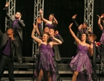 The Dimensions from Austin High School illustrate a song with style as they sing a medley of songs during their performance Saturday, Feb. 28, in the Midwest Showcase show choir competition at Huntington North High School. More than 20 groups from schools around the region sang and danced in the competition, hosted by the HNHS Varsity Singers.