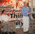 Gov. Mitch Daniels (right) speaks at a ceremony at Continental Structural Plastics in the Riverfork Industrial Park in Huntington on Wednesday, Aug. 11, as the factory announced its newest location that is expected to bring up to 350 jobs to town by 2012.