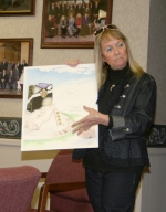 Gloria Holzinger shows a conceptual drawing of the Purple Heart memorial drawn by her son, Rob Holzinger, to a committee meeting Monday, April 20. The group plans to raise $31,000 to pay for the monument, honoring those in Huntington County who shed their blood during combat.