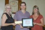 Cheryl Warner (center) receives the Women of the Moose Scholarship from Julia Wine (left), recorder for Women of the Moose, and Karen Price (right), the organization's regent.