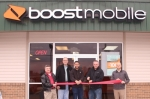 James Scott and Bryan Jones (third and fourth from left, respectively) are the chief marketing officer and vice president, respectively, of Motivated Wireless, a Boost Mobile partner, which is now open in Huntington. The Huntington County Chamber of Commerce held a ribbon-cutting ceremony at the business on Tuesday, Dec. 4. Pictured are (from left) Terry Miller, chamber ambassador; Charlie Chapman, president, Huntington Common Council; Scott; Jones; and Billy Winter, of Bippus State Bank. Not pictured are James Scott Sr. and Jon Simmons, the president and chief operations officer, respectively, of Motivated Wireless.