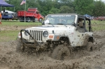 Tony Sitton barrels through the pit with his Jeep during the Andrews Mud Bogs last year. The event, a fund-raiser for the Andrews Volunteer Fire department, will be held Saturday, Aug. 19, on the west end of Terrel Street.
