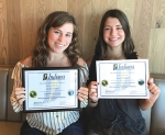 Crosley Stanley (left) and Macy Wohlford each hold a 2019 Indiana Certificate of Multilingual Proficiency. Stanley studied German and Wohlford studied French, both while students at Huntington North High School.