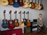 David Geders, storeowner of Copper Chord Music in downtown Huntington, takes a seat next to a keyboard, and wall of guitars. The new music store also offers amps and electric pianos, as well as music lessons and guitar repair.