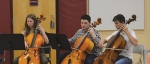 Students from the Parkview Huntington Family YMCA School of Music, (from left) Lizzie Thomson, Tait Didion and Gregory Miller, perform at a community breakfast last spring. The School of Music is currently accepting enrollees for its fall classes.
