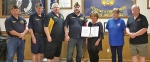 Members of the Veterans of Foreign Wars Post 2689 present Stephanie Till (fifth from left) with the VFW's National Citizenship Education Teacher Award. Celebrating the occasion are (from left) Curt Vanover, VFW Post 2689 quartermaster; Mike Harrell, jr. vice commander; Rick Stell, sr. vice commander; Cory McClure, Post 2689 commander; Till; Mary Whitesell, Post 2689 auxiliary president; and James Kneller, 5th District president.