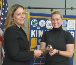 Lisa Garrott (left), new president of the Huntington Noon Kiwanis Club, receives the gavel from Happi Stoffel, lieutenant governor of the Wabash Valley District of Kiwanis.
