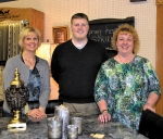 Smith Furniture co-owner Jordan Smith has welcomed sales associates Ivy Selig (left) and Cindy Kelley (right) as the newest staff members of the downtown Huntington store.