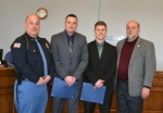 The newest members of the Huntington Police Department are Ty Whitacre (second from left) and Ben Whitman (third from left). With them are Huntington Police Chief Chad Hacker (left) and Mayor Brooks Fetters (right).