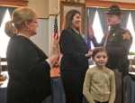 Huntington County Sheriff's Department Deputy Don J. Whitney (right) is sworn in by Huntington County Clerk Kittie Keiffer (left) on Friday, Jan. 6. Whitney's wife, Courtney, holds the Bible as their daughter, Serayna, joins them.