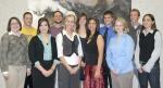 Advisor Heather Barkley (front row, left) poses with the new members of Lambda Pi Eta, a communication studies honor society.
