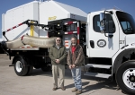 Superintendent Bob Caley (left) and Assistant Superintendent Ralph Asher, of the City Services Street Department, stand in front of their newest equipment, the X-TREME Vac, which will aid in leaf pick-up on city streets starting today.