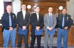 Assistant Chief Pat Scher (left) and Chief E.J. Carroll (right) stand with the three newest members of the Huntington Police Department after the new officers were sworn in on Monday, Feb. 10.
