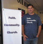 Micah Mobley, new pastor of Faith Community Church of God, stands in the entryway of the church.