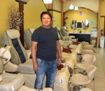 Tuan Phan stands next to the pedicure spa chairs in his shop, KT's Nails, located at 1920 N. Jefferson St., Huntington The salon is open seven days a week and specializes in acrylic nails and pedicures.