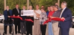 """A ribbon-cutting ceremony was held on Tuesday, July 31, at Our Sunday Visitor, in Huntington, to rechristen the revamped Old U.S. 24 as """"Archbishop Noll Memorial Parkway."""" Pictured are (front row from left) Rev. Ron Rieder, retired pastor of SS. Peter and Paul Catholic Church; Anthony Goodnight, director of public works and engineering services, City of Huntington; Mayor Brooks Fetters; Monsignor Owen Campion, retired associate publisher of OSV; Kyle Hamilton, chief executive officer, OSV; Karen Schafbuch, Archbishop Noll family; Gregg Koppelmann, Huntington area manager, E&B Paving; Jim Lewis, president, Huntington Area Recreational Trails Association; and Kevin Noll, Archbishop Noll family; and (back row from left) Adam Cuttriss, assistant director of public works and engineering services, City of Huntington; Steve Yoder, superintendent of parks and recreation, City of Huntington; Seth Boyd (partially obscured), design engineer, DLZ; and Bryn Keplinger (obscured), director of community development and redevelopment, City of Huntington."""