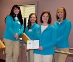 The therapy services program at Norwood Health and Rehabilitation has been recognized through a national survey for excellent customer service. Displaying the award are (from left) Wendy Trosper, rehabilitation aide; Laura Brooks, physical therapy assisstant; Amy Owens, physical therapist and facility rehabilitation director; and Sheena Brown, rehabilitation supervisor.