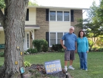 Pete and Vicki Allen stand in the yard of their home at 4161N-580W. They were one of three couples who received Norwood Homeowners Association Yard of the Month awards.