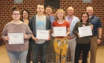 The LaFontaine Arts Council's Artists of the Month for November are eighth-grade students from Crestview Middle School. They are (front row from left) Emily Good, Cameron Oswald, Cadence Reed and Gloria Friesen. The teachers who nominated them are (back row from left) Liesl Haupert, art; Peter Kitchen, CTV; Doug McElhaney, band; and Bryan Ringo, choir.