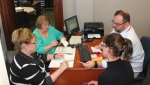 Members of the Huntington County Election Board go over tallies of votes cast in the primary election on Tuesday, May 3. Pictured are (from left) Kittie Keiffer, Huntington County Clerk; Linda Beatty, Democrat Party representative and president of the election board; Ryan Wall, MicroVote technician; and Lori Guy, Republican Party representative.